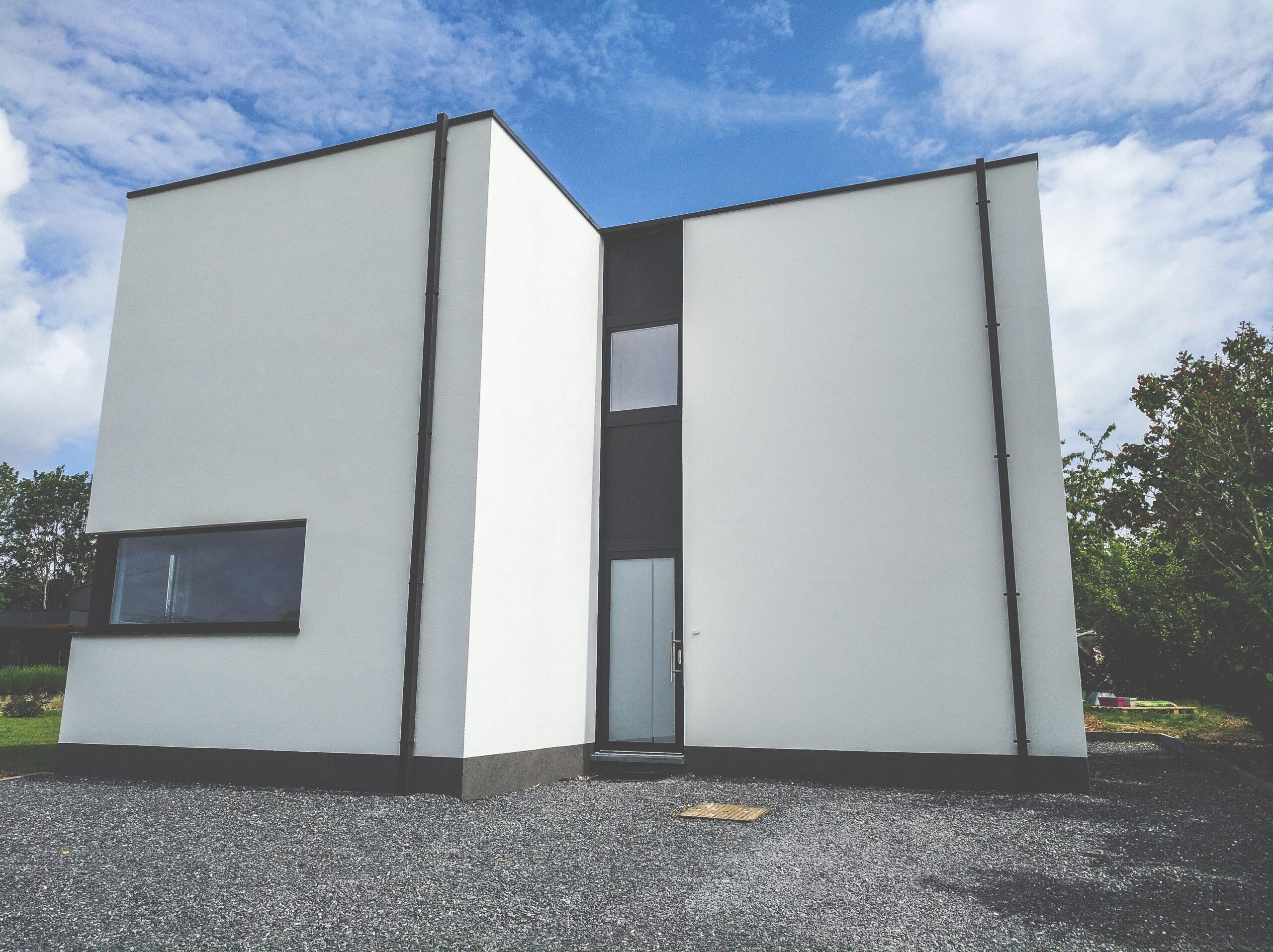 Maison Unifamiliale - Loyers - Façade avant 1 - Owood Constructions